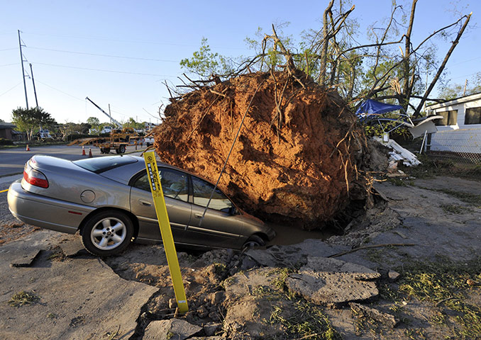 Carolina Tornado: A car is swallowed up by a hole following the tornado