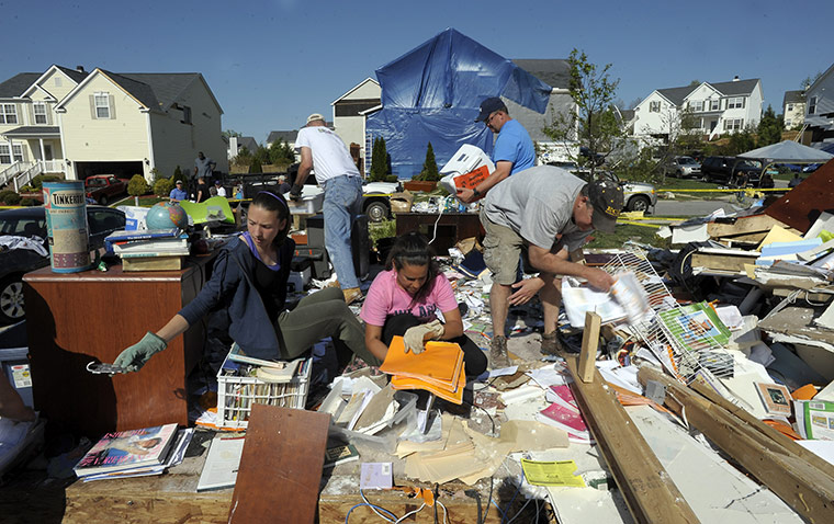 Carolina Tornado: Volunteers help sort through what was the office of a home
