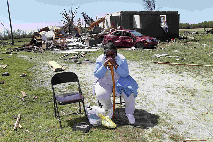 Carolina Tornado: Mary Grady sits in her neighbour's yard