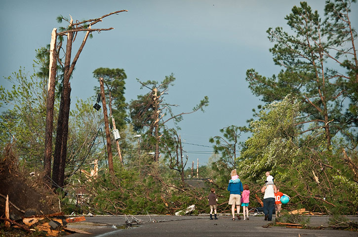 Carolina Tornado: People walk through the neighborhood to assess the damage