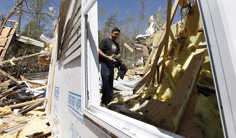 Carolina Tornado: Steve Sawyer sorts through debris at a home that was destroyed