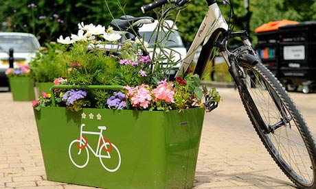 bicycle leaning against flower pot