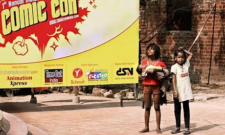 Children in Delhi, next to a billboard for a comic book fair