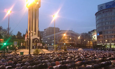 Syrians pray in Clock Square