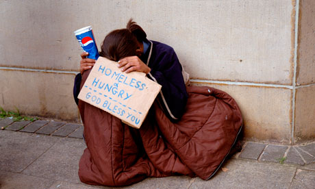 Young person homeless hungry and begging in London.