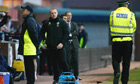 Celtic manager Neil Lennon is flanked by police and security