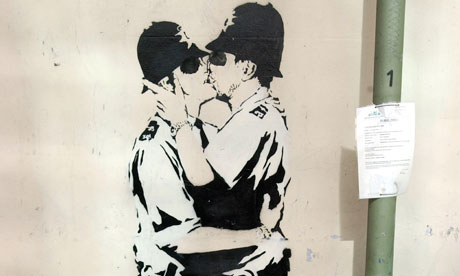 Kissing cops graffiti by Banksy