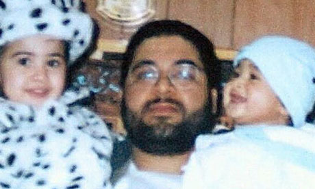 Shaker Aamer with two of his children, son Michael and daughter Johninh, in an undated photograph