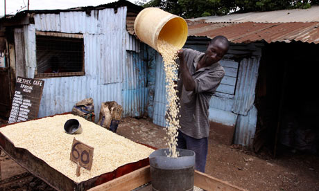 Stephen Omondi works at his stall selling maize in Kibera slum, Nairobi