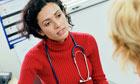 GP talks to patient