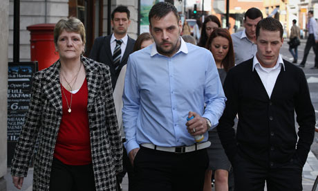 The widow of Ian Tomlinson, Julia, and stepsons Paul and Richard King at the inquest in London