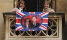 Wellwishers display a William and Kate banner near  Westminster Abbey before the royal wedding