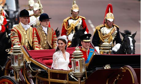 Royal Wedding - Prince William and Catherine smile as they make the journey by carriage