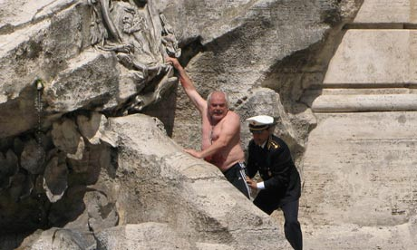 Roberto Cercelletta is removed from the Trevi fountain by police
