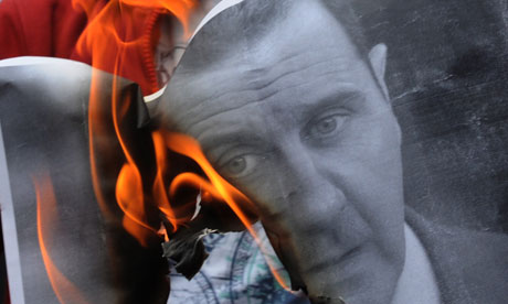 Bashar al-Assad portrait on fire