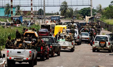 Convoy of soldiers loyal to Ivory Coast presidential claimant Ouattara in Abidjan
