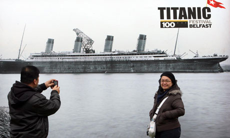 Tourists look at one of the exhibits in a TITANIC EXHIBITION in ...