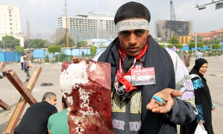 An Egyptian protester shows spent bullets after Egyptian soldiers stormed Tahrir Square