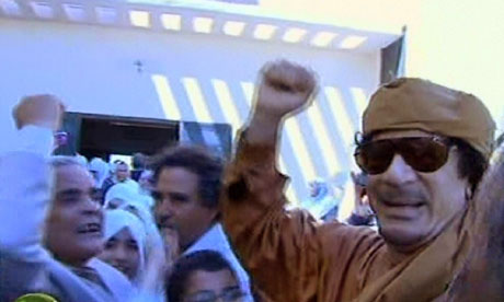 Muammar Gaddafi arriving at a school in Tripoli