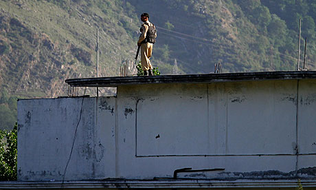 A Pakistani soldier on the roof of Osama bin Laden's hideout