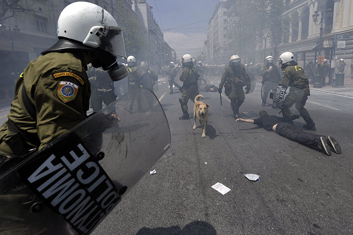 Protests in Athens: Greek riot police arrest a demonstrator during a protest in Athens