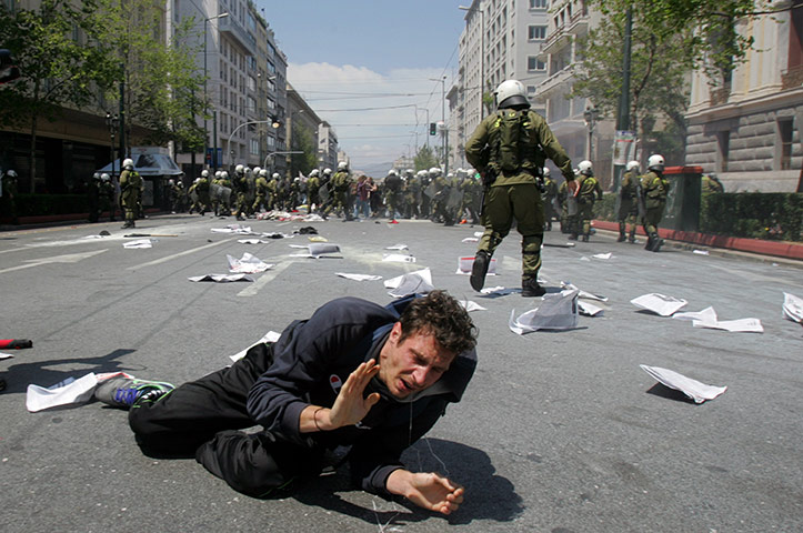 Protests in Athens: A protester falls to the ground during clashes with police