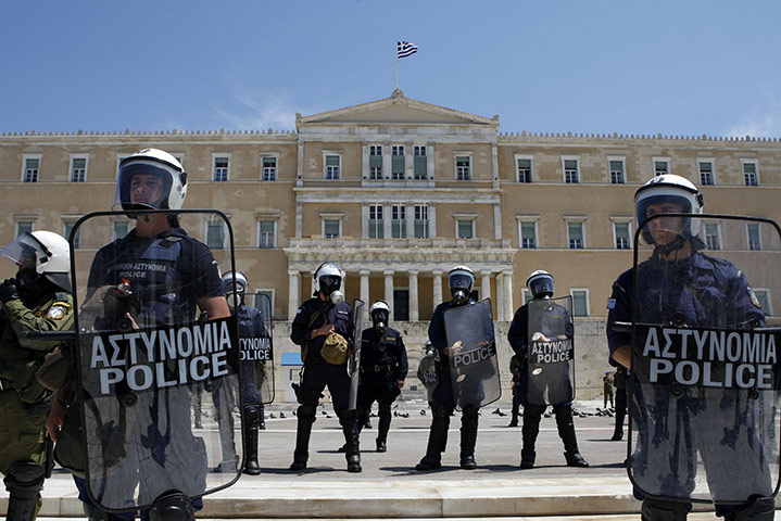 Protests in Athens: Riot police stand outside the Greek parliament
