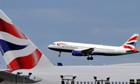 A British Airways plane flies into Heathrow airport