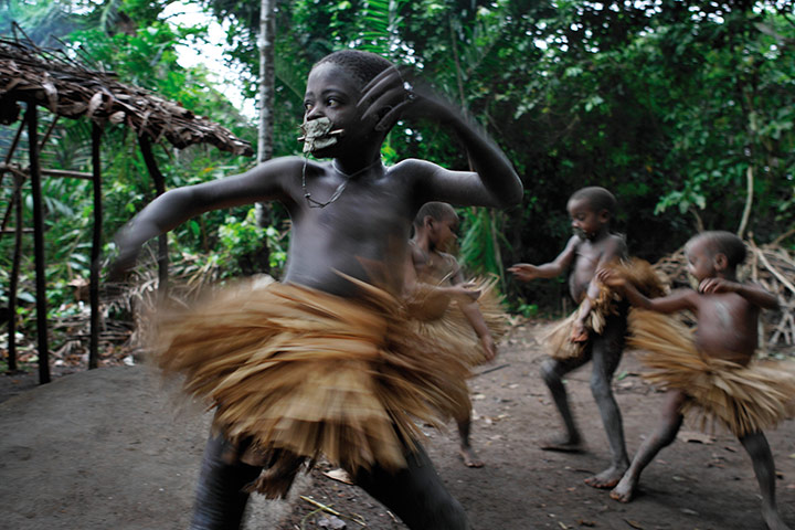 Disappearing world: Mbuti boys wear grass skirts during their nkumbi circumcision ceremony.
