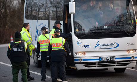 Danish police check a coach at the Danish-German border
