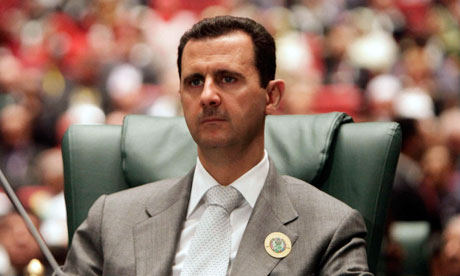 File picture of Syria's President Bashar al-Assad attending the Arab League summit in Sirte