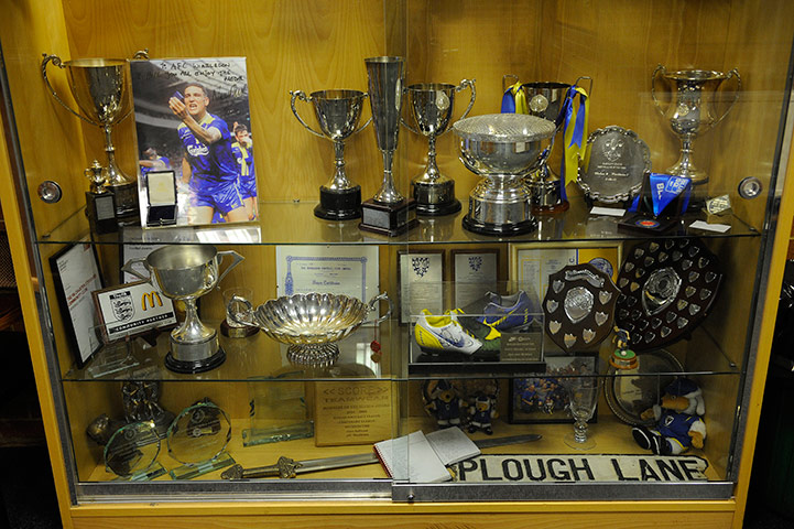 The Trophy Cabinet At Kingsmeadow With A Message And FA Cup Winners Medal From Vinnie Jones Road Sign Old Ground Plough Lane