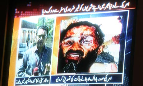 TV news in Pakistan shows a handout picture of Osama bin Laden, leader of al-Qaida.