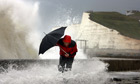 man with umbrella fighting against storm