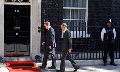 Barack Obama and David Cameron enter 10 Downing Street