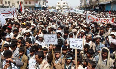 Residents of the Yemeni province of Saada hold placards