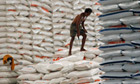 A worker unloads sacks of rice that belong to Indonesia's state procurement agency, Bulog