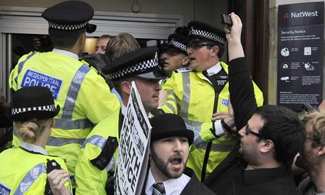 Police struggle with activists outside the NatWest bank in Camden Town, London