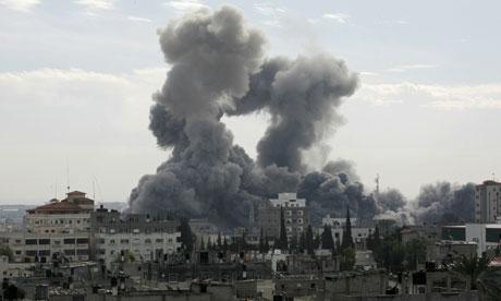 Smoke billows from the Gaza Strip following Israeli air strikes in December 2008