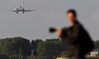 A plane with Ratko Mladic aboard prepares to land at The Hague Airport