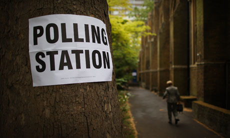 A voter attends a polling station at St John's Parish Hall near Hyde Park