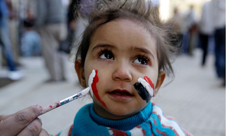 Girl has her face painted during a rally in Tahrir Square