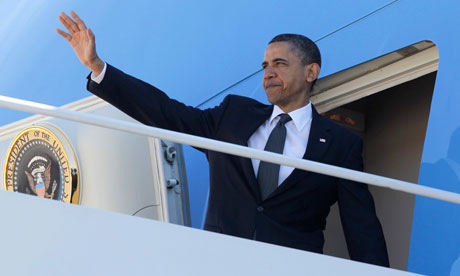 Barack Obama waves as he boards Air Force One at Andrews air base Maryland to fly to ground zero
