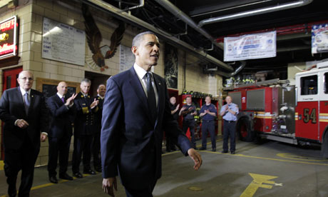 Barack Obama with firefighters in New York on 5 May 2011. Rudy Giuliani is on the left.