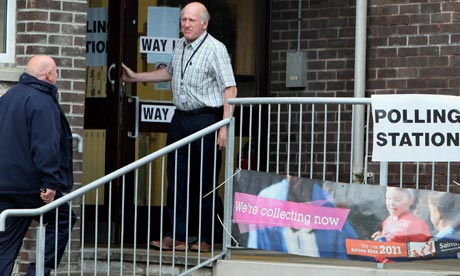 A Northern Irish voter enters a polling station in Carnlough, Co Antrim