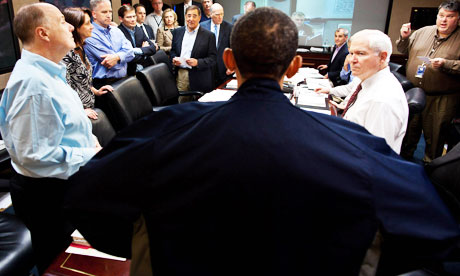 Barack Obama looms at the head of the table in this photograph from the White House situation room