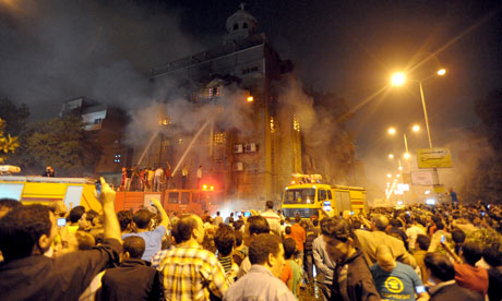 Egyptians gather outside a burning church in Cairo