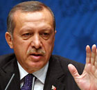 Erdogan offers to help Gaddafi leave Libya