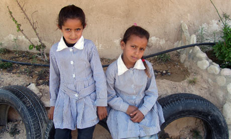 Nisreen, 8, and her sister Iman, 6, in front of the Khan al-Ahmar primary school in the West Bank
