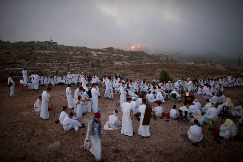 Members of the Ancient Samaritan community pray during a pilgrimage